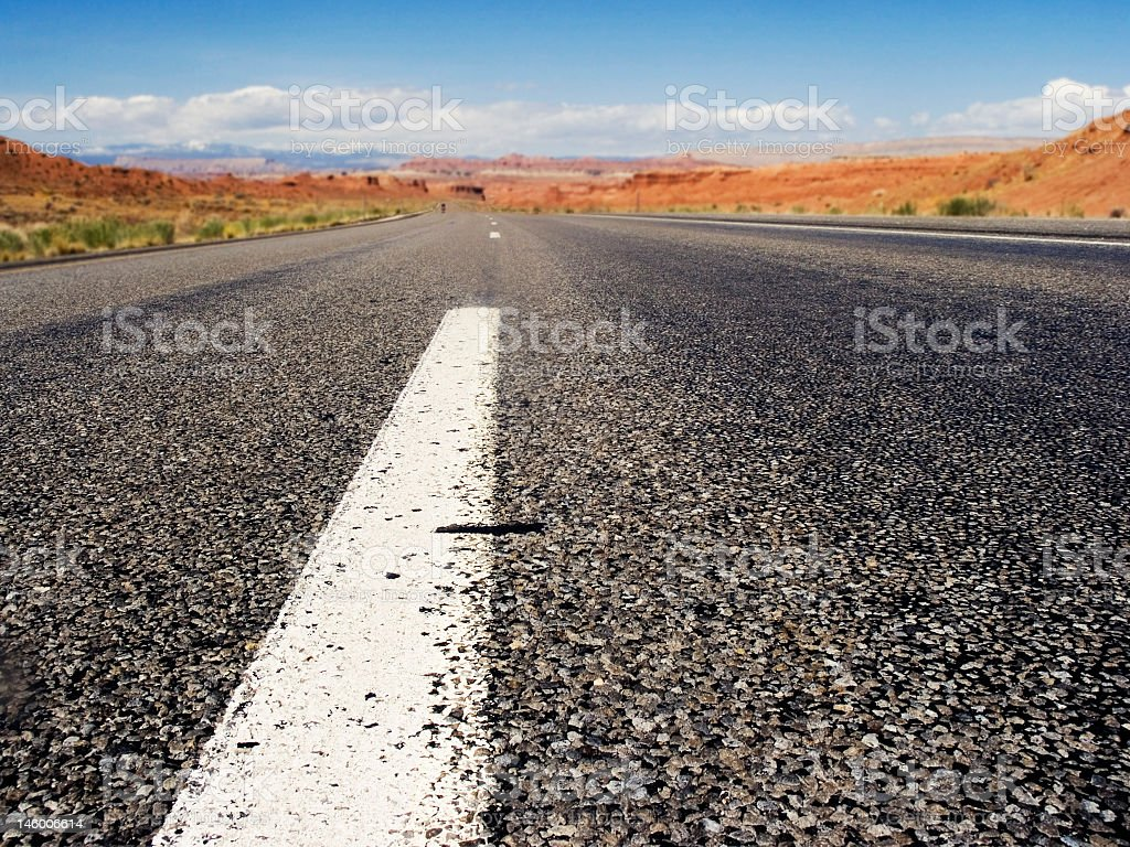 Closeup view of endless desert road stock photo