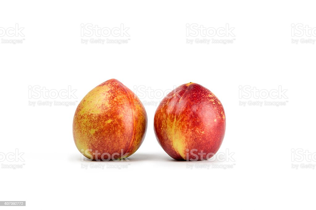 close-up view of fresh nectarine isolated on white background. stock photo