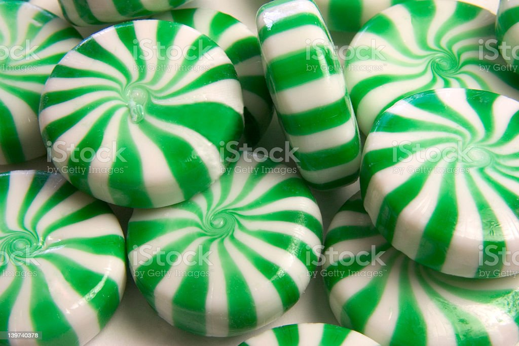 Closeup view of green and white mints stock photo