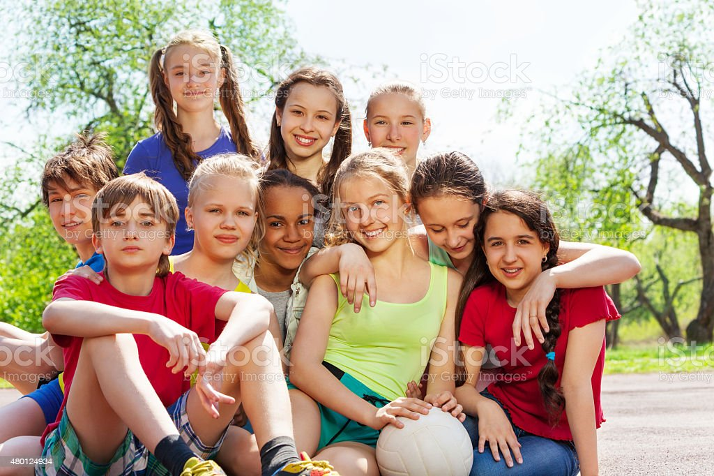 Close-up view of happy teenagers sitting close stock photo