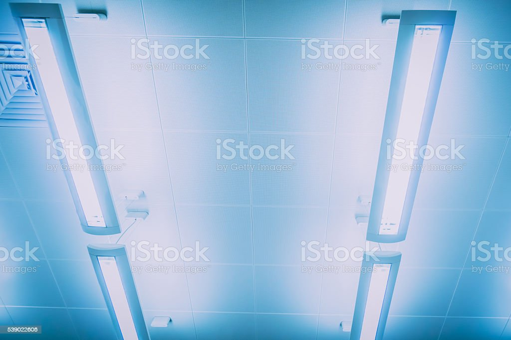 Close-up view of indoor lighting bars hanging from ceiling stock photo