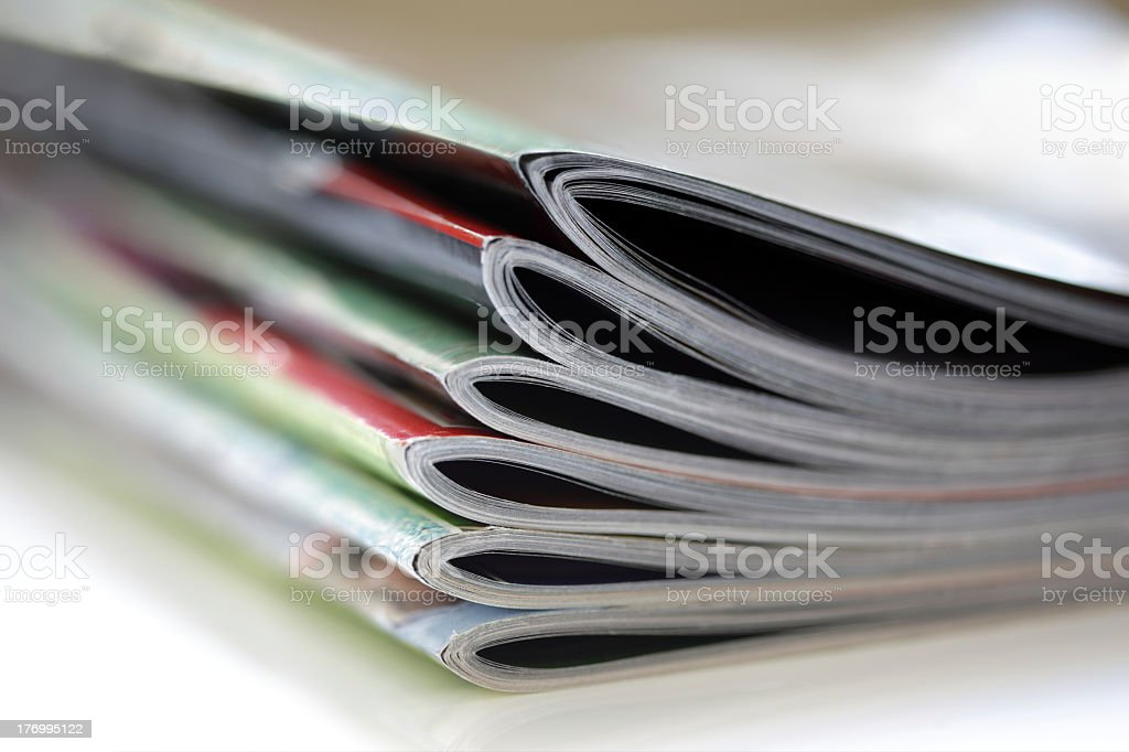 Closeup view of magazines pile stock photo