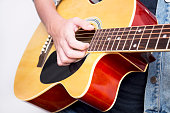 Close-up view  of male hands playing guitar