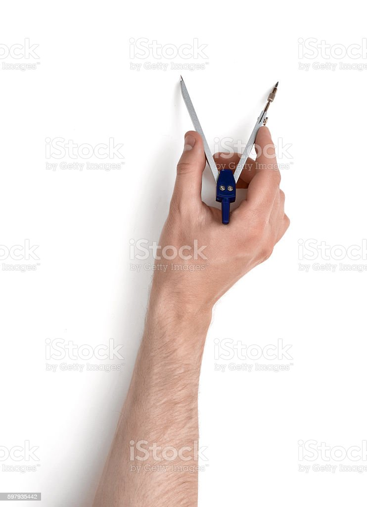 Close-up view of man's hand with drawing compass stock photo