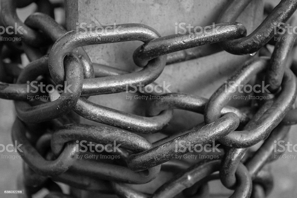 Close-up view of old rusty chain links. stock photo