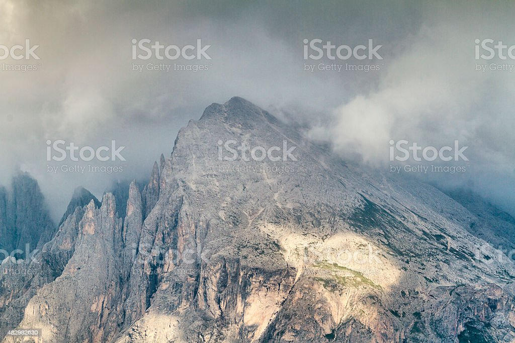Close-up view of Plattkofel in cloudy day stock photo
