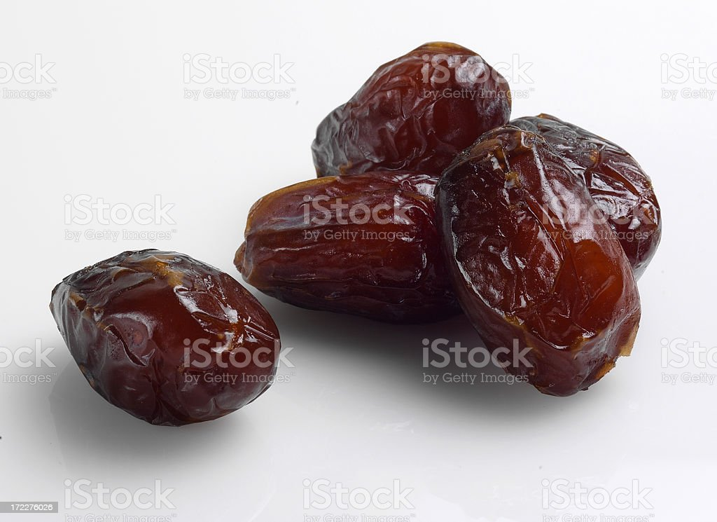 Close-up view of prunes isolated on white background stock photo