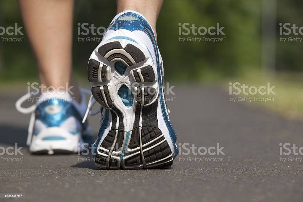 Close-up view of sports shoes in mid stride royalty-free stock photo