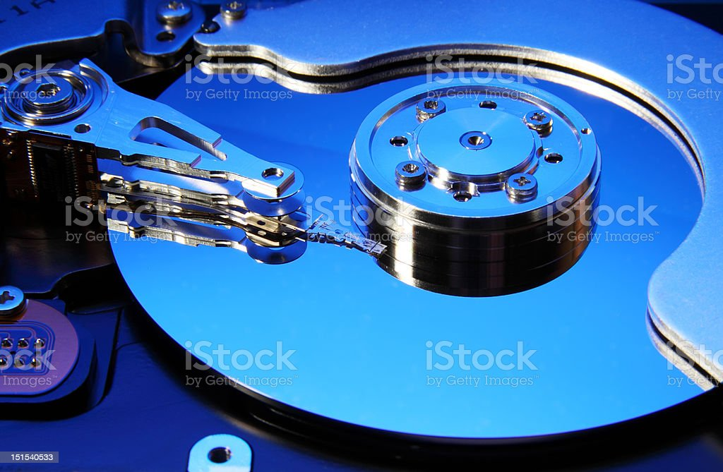 Close-up view of the opened hard disk drive stock photo