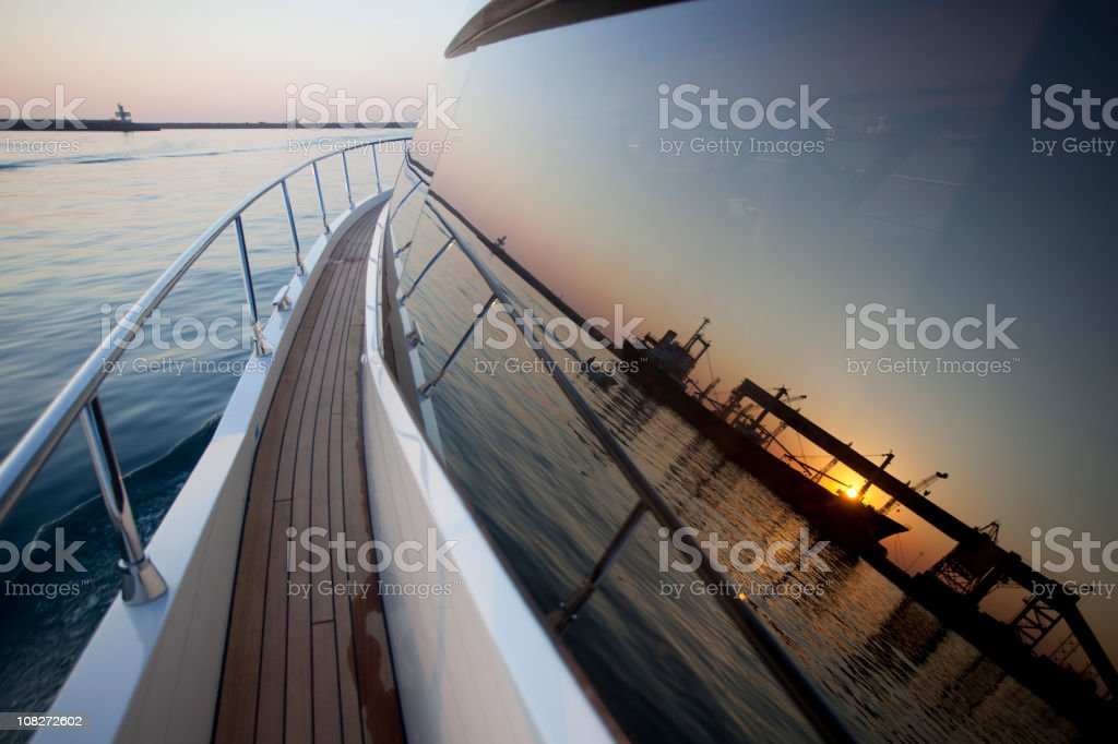 Close-up view of the side of a boat on calm waters royalty-free stock photo