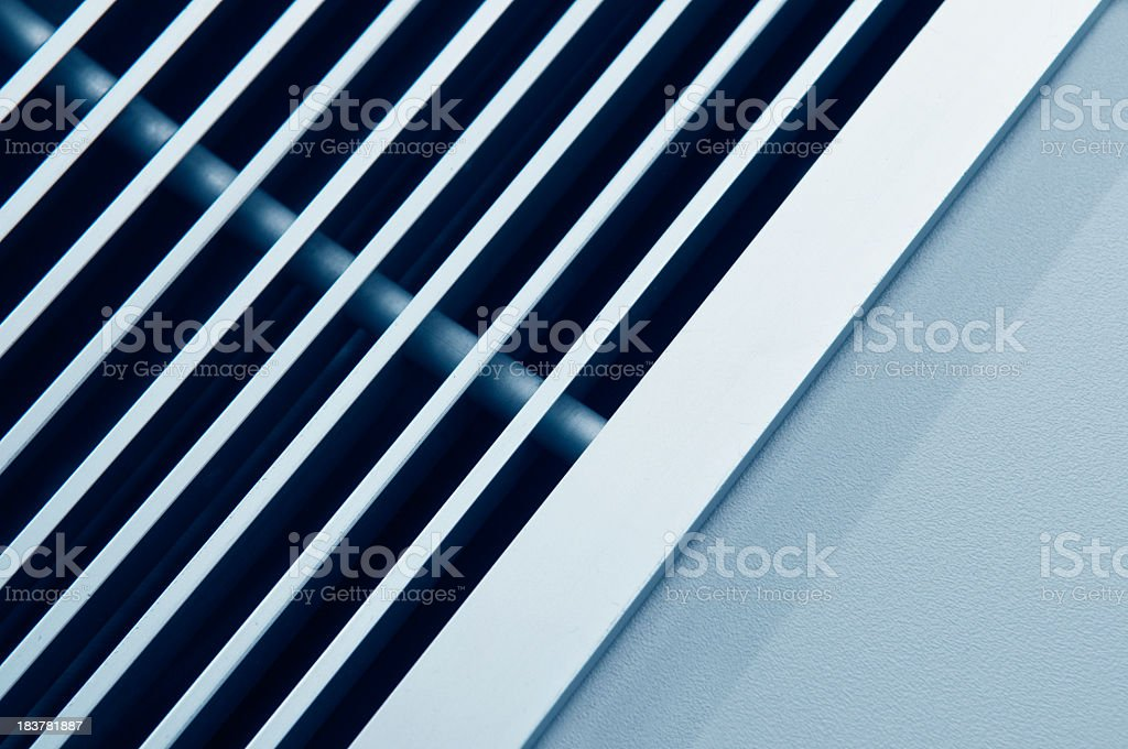 A close-up view of the vents of an air conditioner stock photo