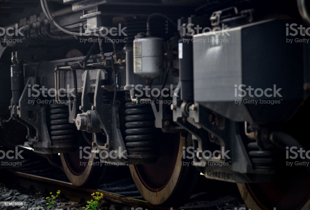 A closeup view of the wheels of a train stock photo