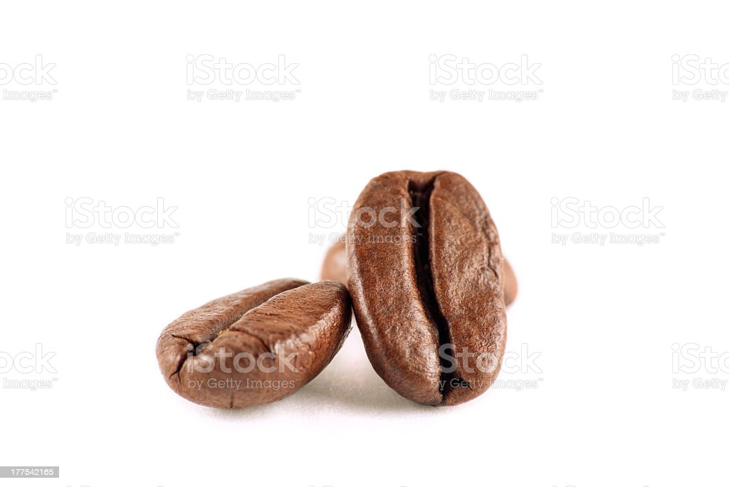 Close-up view of three coffee beans isolated on white stock photo