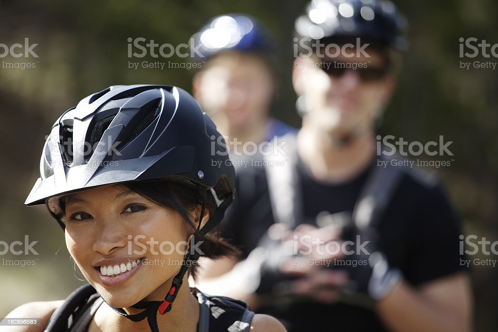 Close-up view of three cycle buddies, focus on female biker stock photo