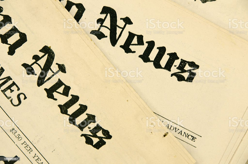 Close-up view of two old yellowed newspaper Headline stock photo