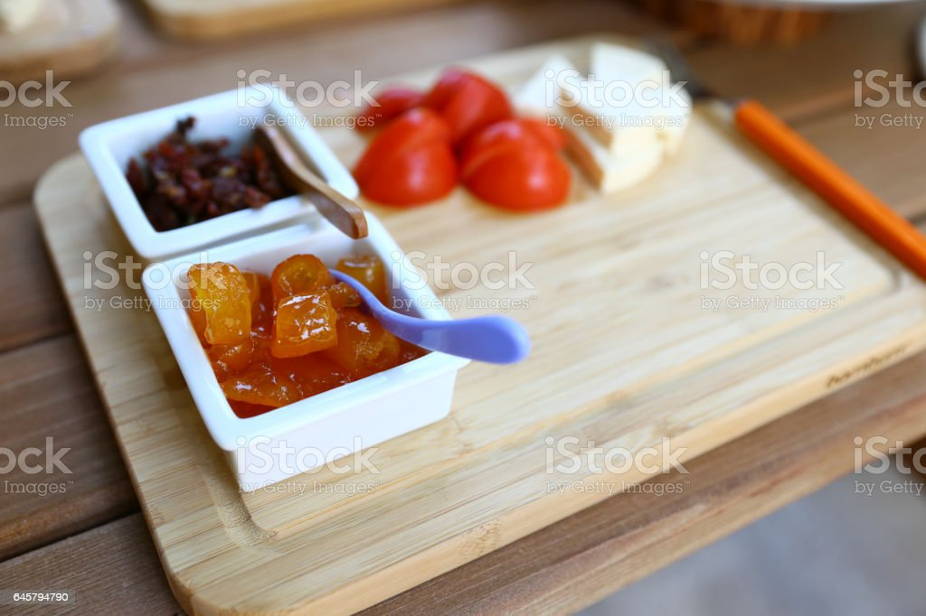 Closeup view of wooden breakfast plate stock photo