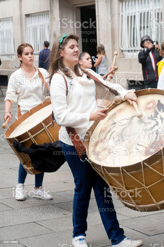 Close-up view of young female drummers in a street marching band. stock photo
