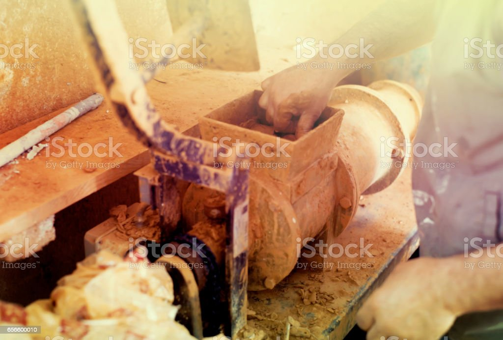Closeup view on clay forming machine stock photo