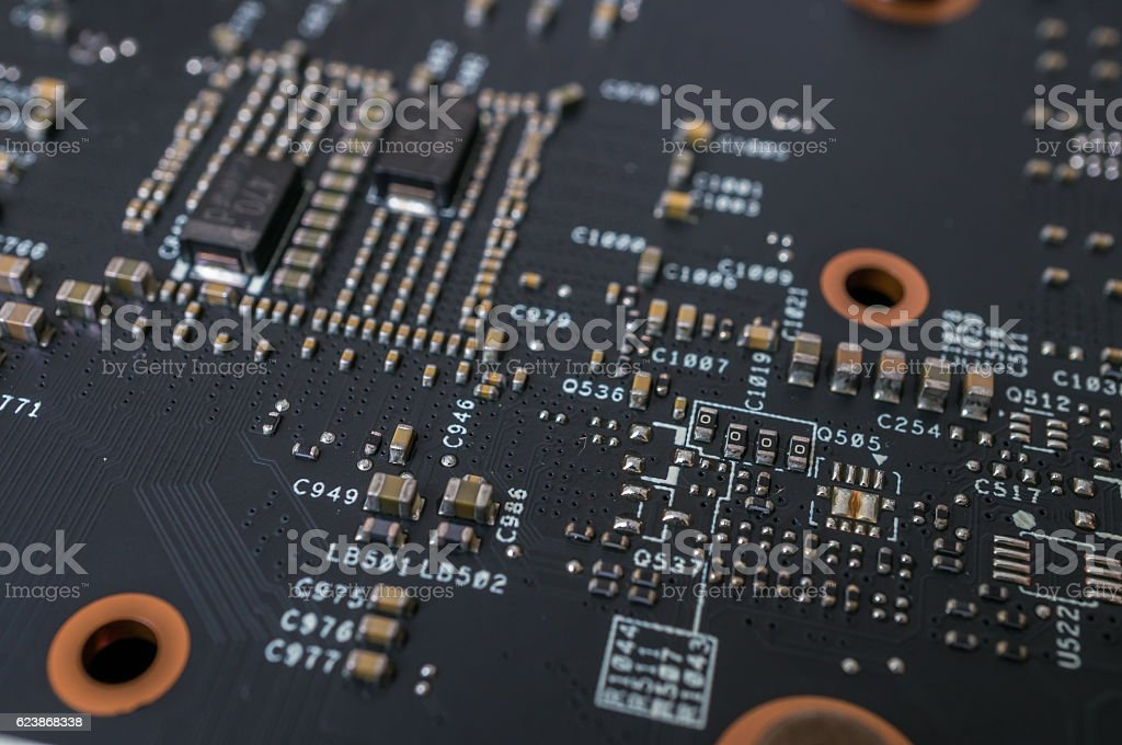 Closeup view on electronic circuit of videocard. stock photo