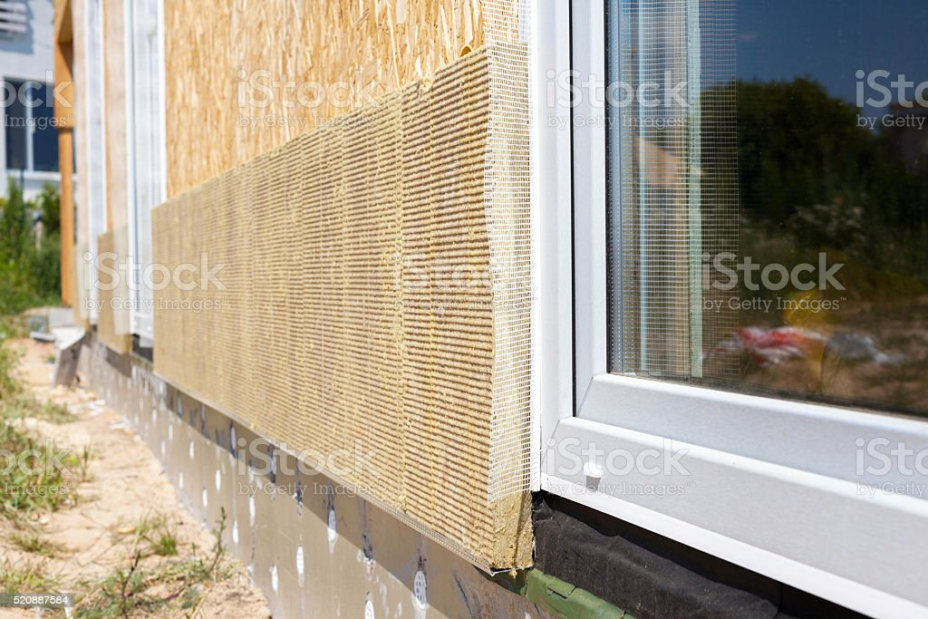 Closeup view on house wall with plastic window stock photo