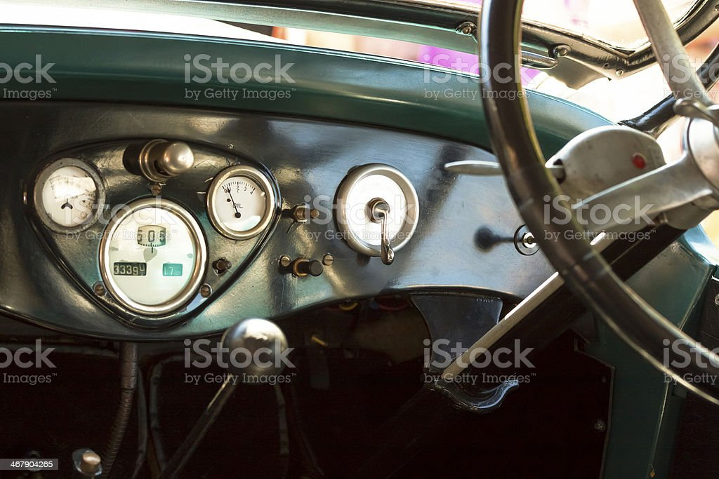 Closeup vintage car dashboard with steering wheel stock photo