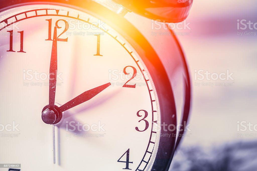 closeup vintage clock focus at 2 o'clock with sun light stock photo
