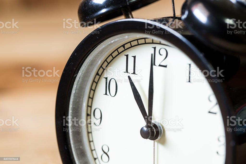 closeup vintage clock selective focus at number 11 o'clock stock photo