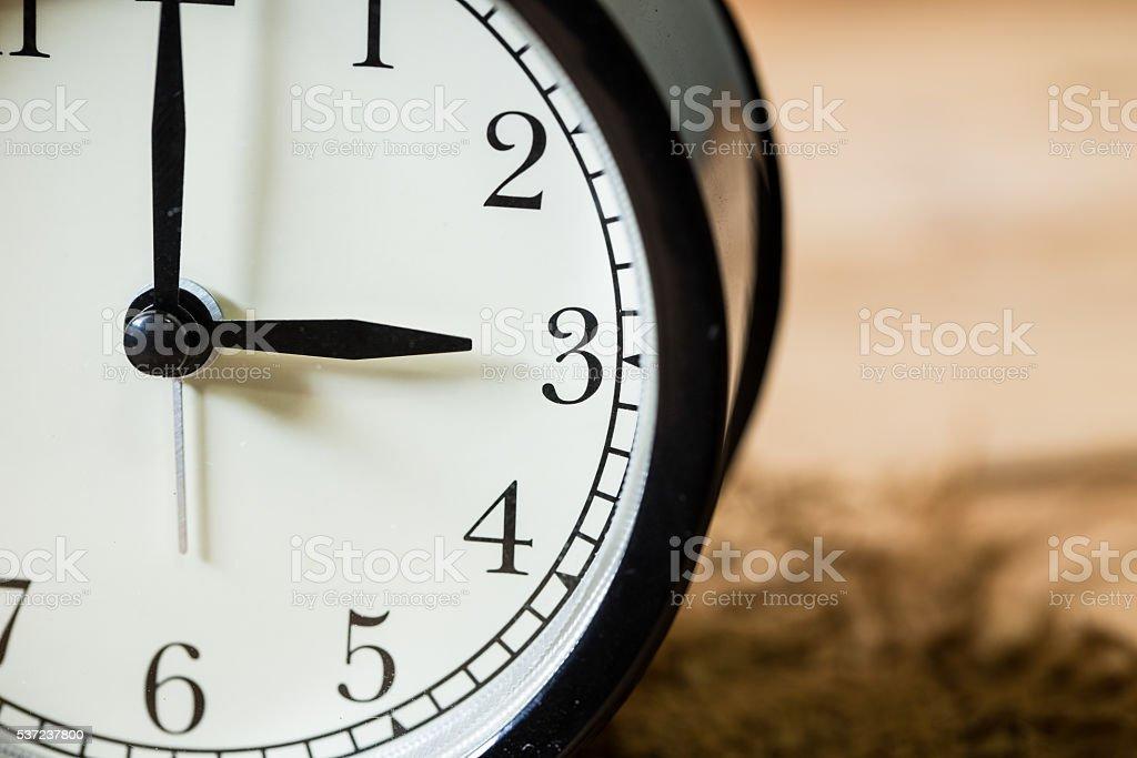 closeup vintage clock selective focus at number 3 o'clock stock photo