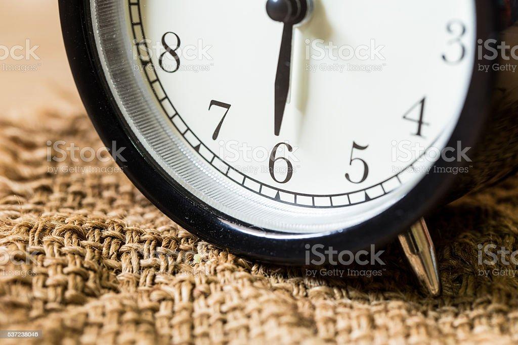 closeup vintage clock selective focus at number 6 o'clock stock photo