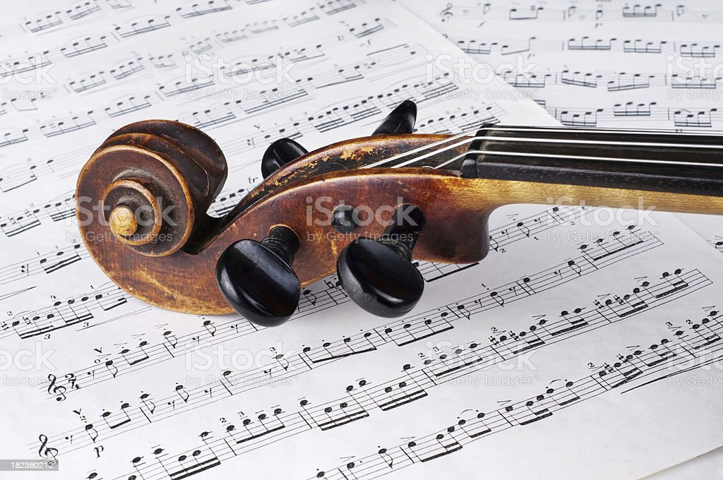 Vintage violin and musical score. Stradivarius violin made in...