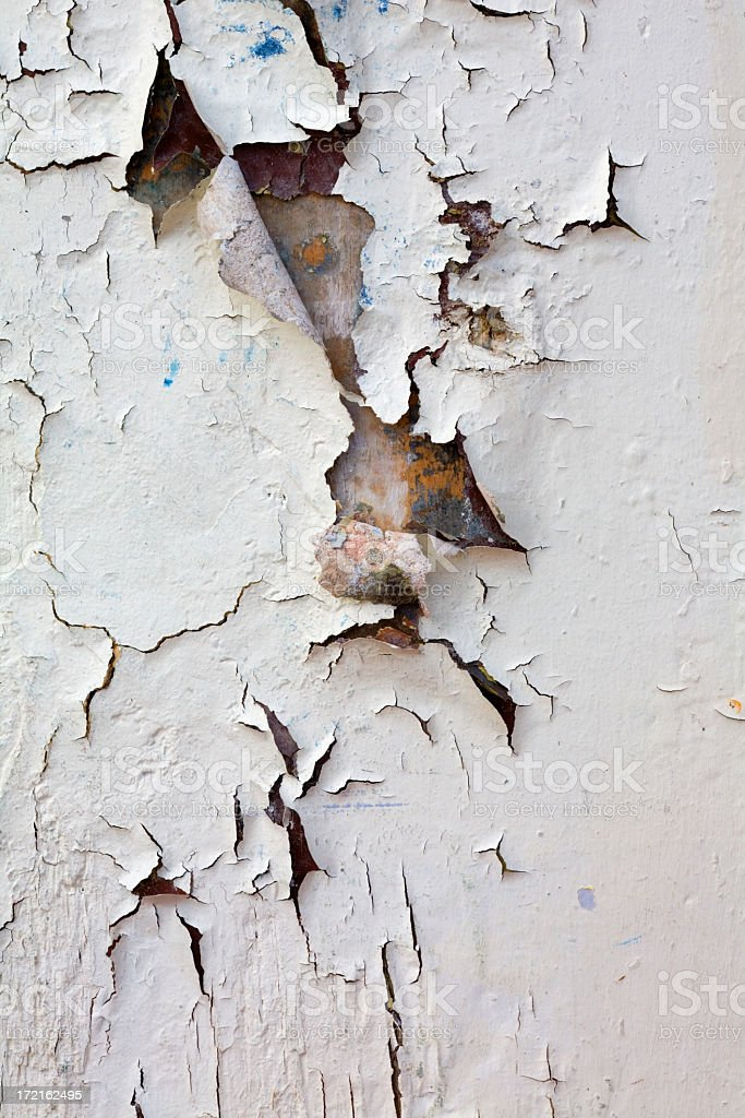 Closeup wall section with heavy peeling white paint stock photo