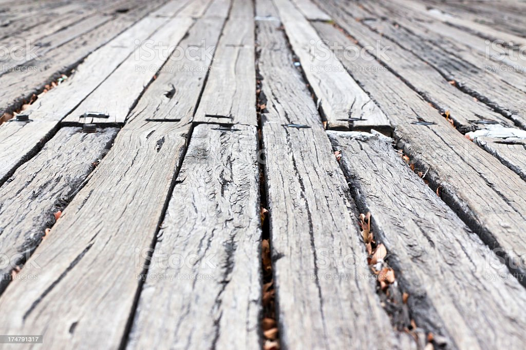 Closeup weatherd wooden sleepers road with copy space royalty-free stock photo