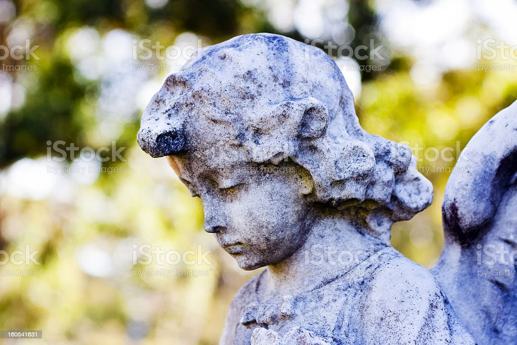 Closeup weathered statue of little angel, copy space royalty-free stock photo