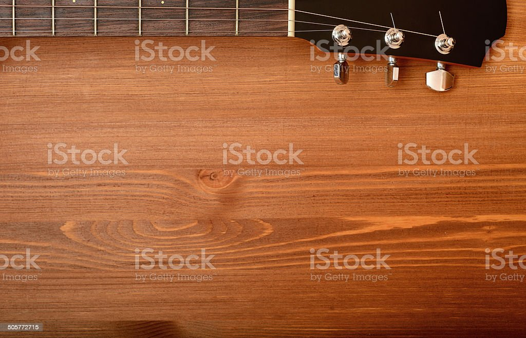 Close-up western guitar neck on wooden background stock photo