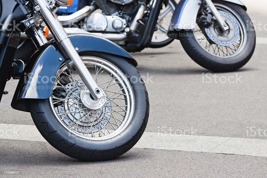 Closeup wheel of motorbike standing on the road, copy space royalty-free stock photo