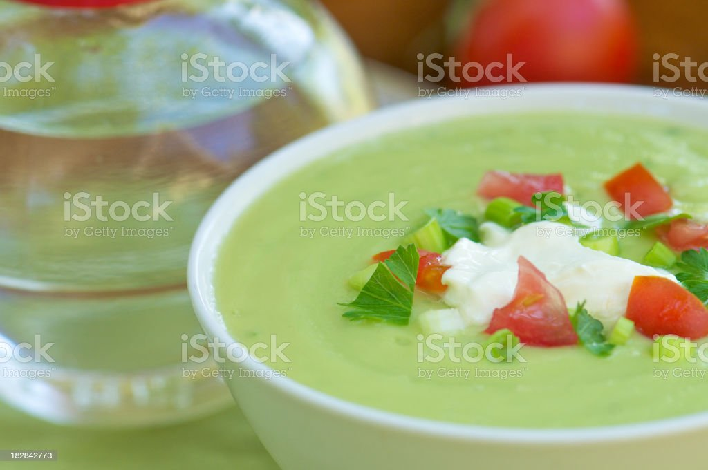 Close-up White Bowl of Cold Avocado Soup royalty-free stock photo