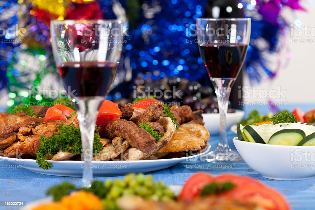 Close-up wine and food on the table with Christmas decoration royalty-free stock photo