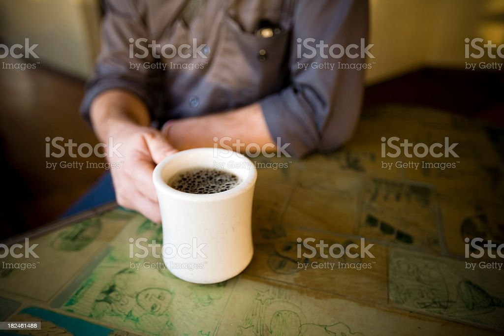 A close-up with a man holding a cup of coffee stock photo