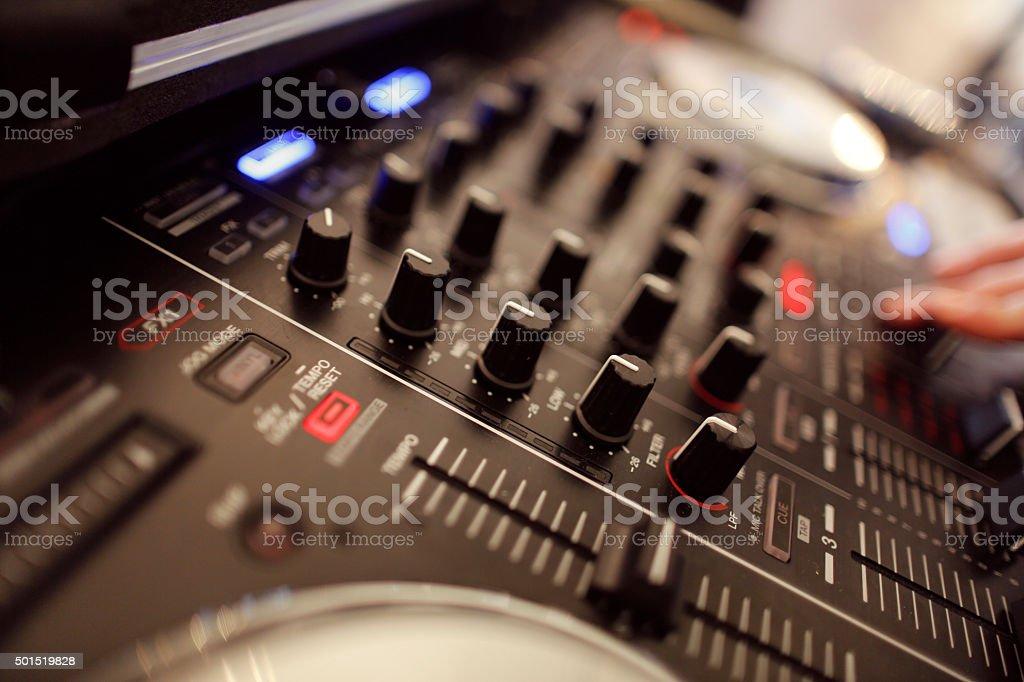 Closeup with DJ equipment with mixer nobs stock photo