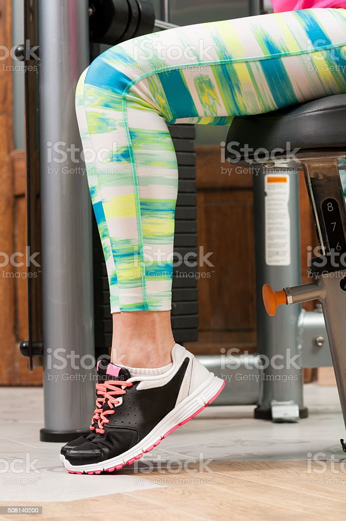 Closeup with woman feet wearing sport shoes stock photo