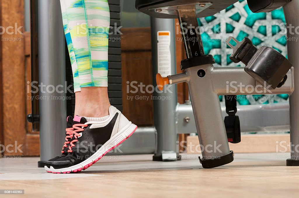 Close-up with woman feet wearing training shoes stock photo