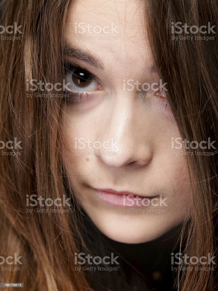 Closeup woman covers the face by long brown hairs royalty-free stock photo