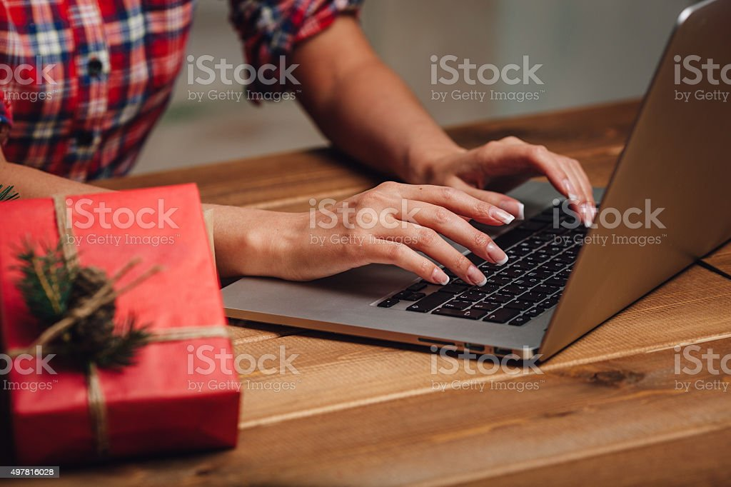 closeup woman hands  working with laptop stock photo