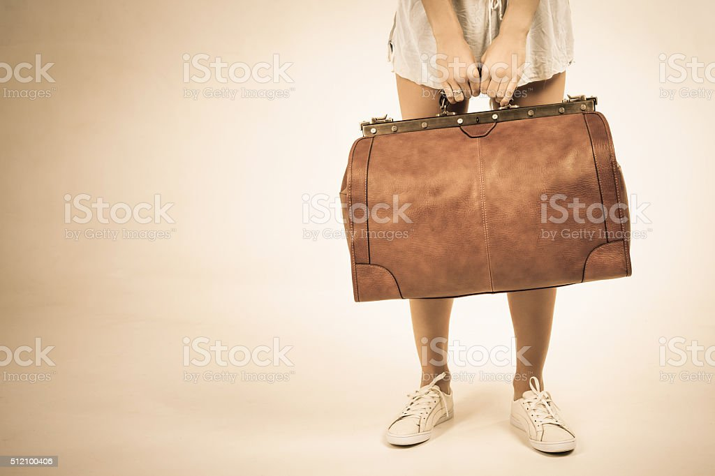 Closeup woman holding hand luggage, weight and baggage dimensions stock photo