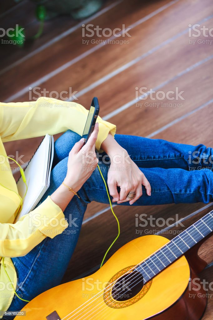 Closeup woman music lover using a phone for entertainment. stock photo