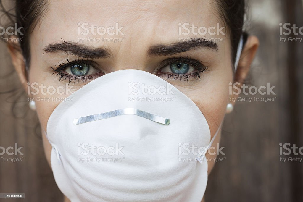 Close-up woman wearing a face mask stock photo