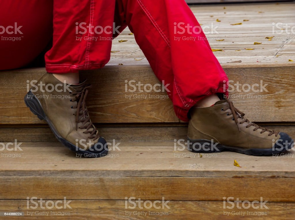 Close-up Woman's Legs in Shoes and red Jeans giving Rest stock photo