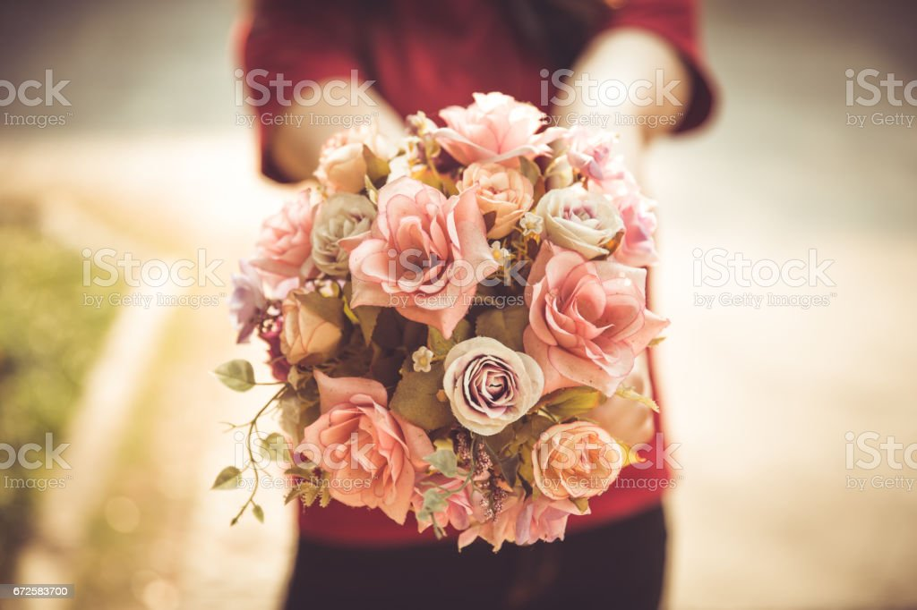 closeup women hand hold rose flower love blossom lovely lover beautiful vintage style color tone stock photo