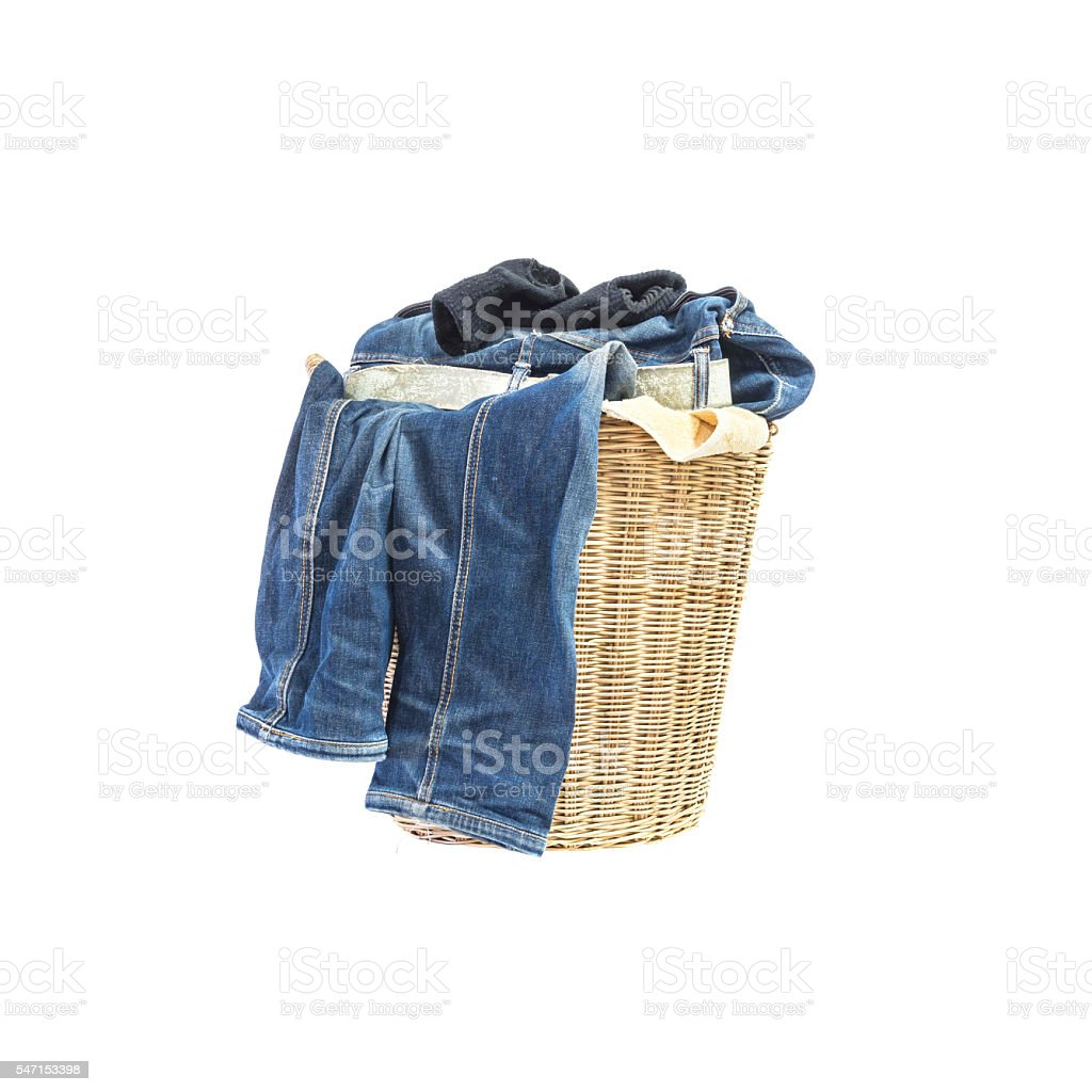 Closeup wood weave basket with pile of clothes isolated stock photo