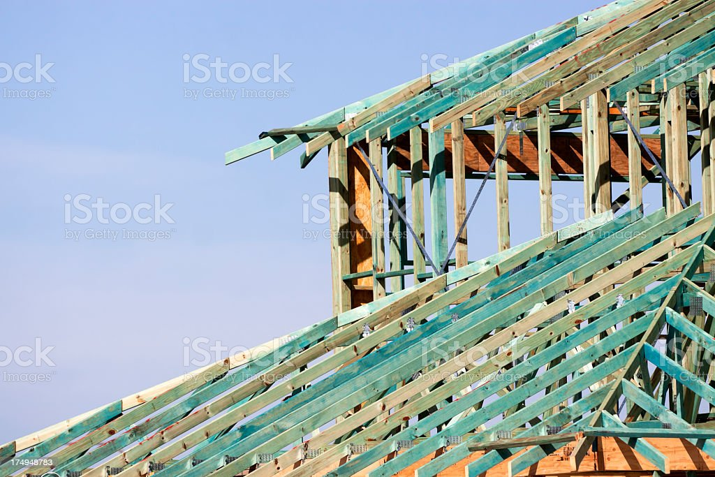 Closeup wooden construction house frame with roof trusses, copy space royalty-free stock photo
